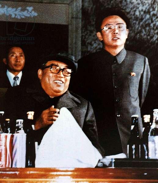 Korea: North Korean leader Kim Il Sung (seated) with his son and successor Kim Jong Il, Pyongyang, 1980