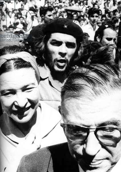 Cuba: Jean-Paul Sartre and Simone De Beauvoir with Ernesto Che Guevara on a busy street, Havana, 1960.