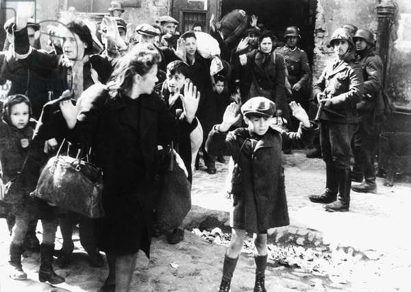 Poland/ Germany: Jewish men, women and children surrender to Nazi soldiers during the Warsaw Ghetto Uprising, May 1943 (b/w photo)