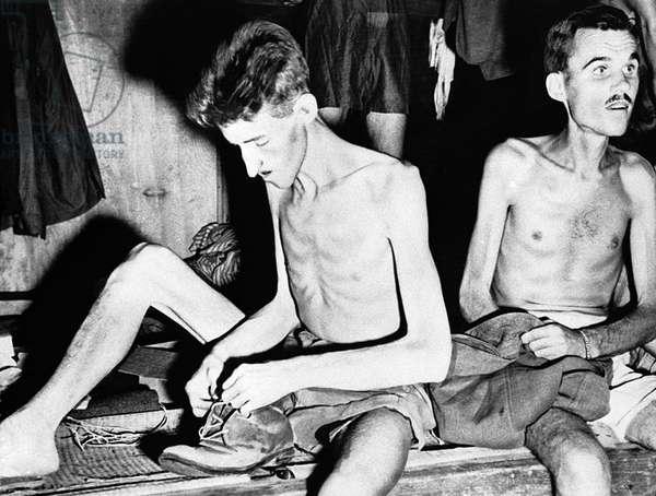 Japan: Two emaciated allied prisoners of war after their release from captivity near Yokohama, World War II, 11 September, 1945