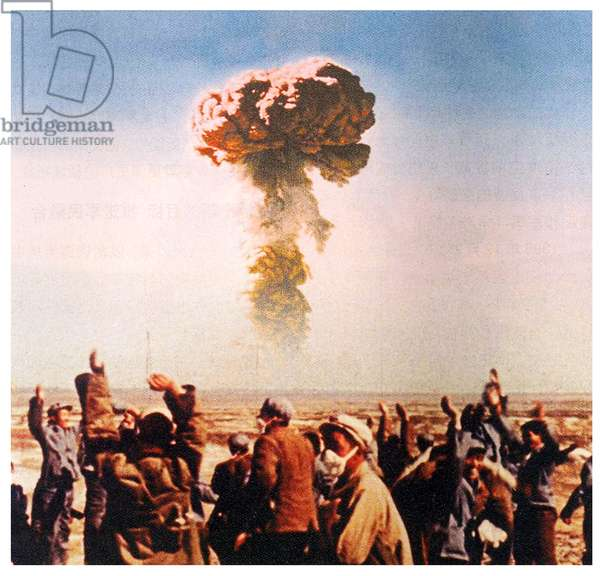 China: Workers and technicians at the Lop Nur Nuclear Weapons Test Base, Xinjiang, celebrate China's first nuclear bomb explosion, October 16, 1964