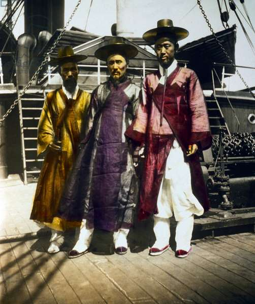 Korea: Three well-to-do Korean men posed on the deck of a ship, late 19th century