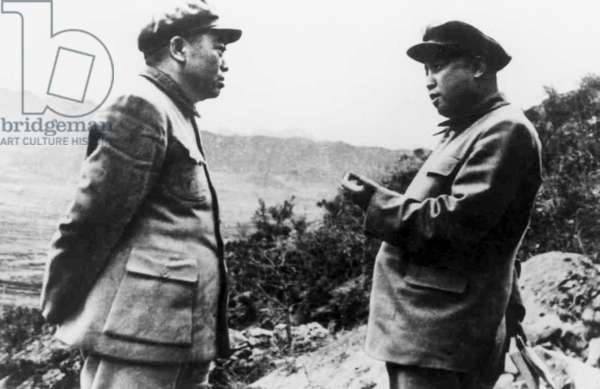 Korea / China: Peng Dehuai (left), Commander in Chief Chinese People's Volunteer Army in Korea, discusses strategy with North Korean leader Kim Il-sung somewhere in North Korea, c. 1951