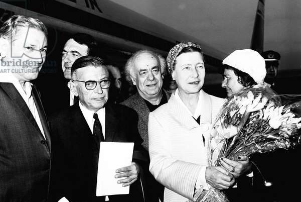 Israel-Palestine: French philosophers Jean Paul Sartre and Simone De Beauvoir arriving at Lod Airport, 14 March 1967