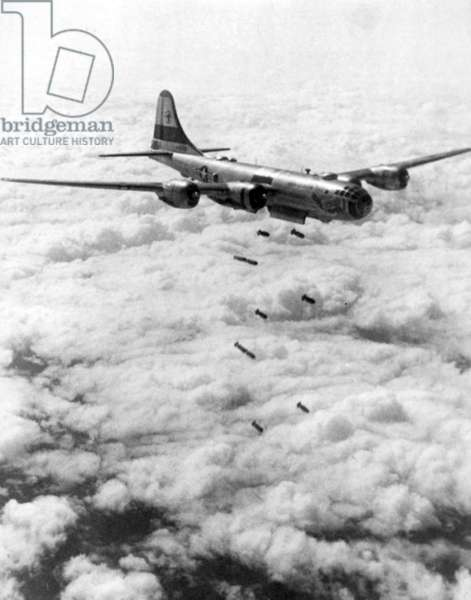 Korea: A USAF B-29 Superfortress bomber unloading its bombs over North Korea, August 1951