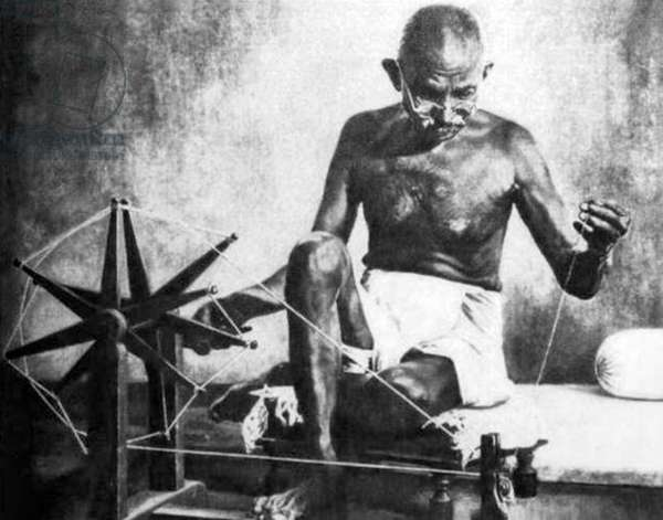 India: India: Mohandas Gandhi spinning with charkha wheel during his imprisonment at Yerwada Jail, 4 January 1933 - 1 August 1933
