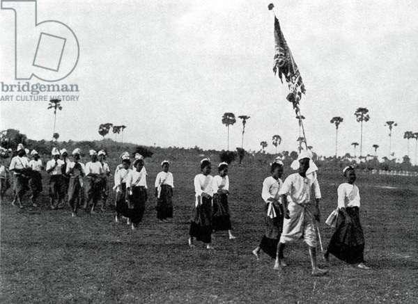 Thailand: A festive parade in Phetchaburi, Thailand, late-19th century.