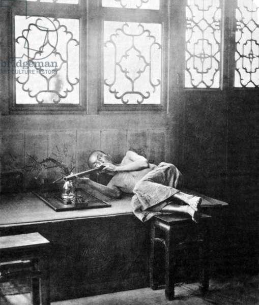 China: 'Opium Smoking in a Restaurant'. John Thomson, 1874