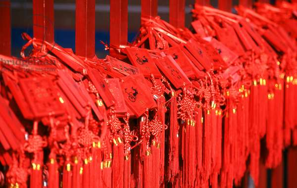 China: Chinese New Year blessing tablets hang from posts in the Beijing Dongyue Temple (Temple of the God of Taishan Mountain), a Taoist temple, Beijing