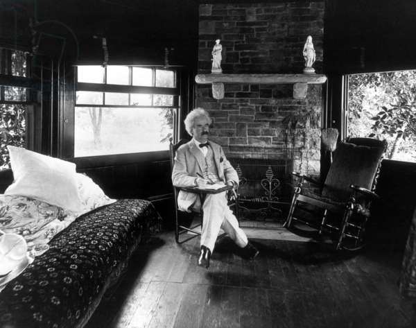 USA: Samuel Langhorne Clemens, aka Mark Twain, American writer, traveller and humorist (1835-1910), seated in his study at Quarry Farm, Elmira, New York, 1903