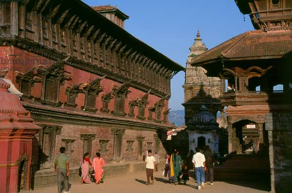 Nepal: The Palace of Fifty-Five Windows (left), the 17th century Siddhi Lakshmi Temple (background, centre) and the Chyasalin Mandap Temple (right), Durbar Square, Bhaktapur (1997) (photo)