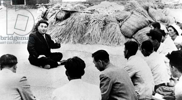 Korea: Communist leader Kim Il Sung talking with farmers from Qingshanli, Kangso County in North Korea, October 1945