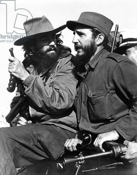 Cuba: Camilo Cienfuegos (left) talks with Fidel Castro (right), Havana, 1959