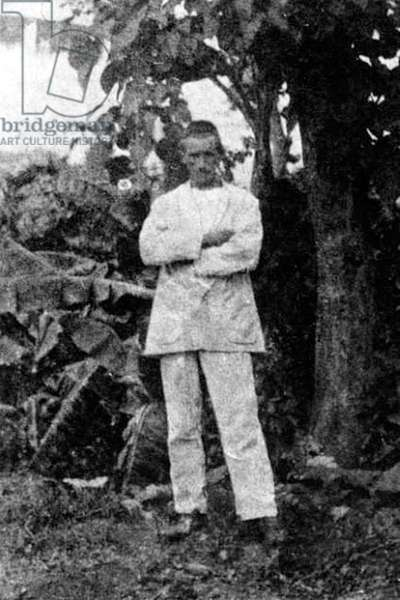France/Ethiopia: Arthur Rimbaud (1854 - 1891) standing in front of a tree in Harar. Self-portrait, c. 1883