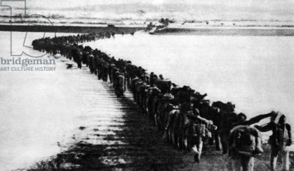 Korea: North Korean picture showing troops of the Chinese People's Volunteer Army (CPVA) crossing the frozen Amrokgang River in North Korea, 1950