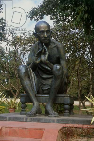 India: Mohandas Karamchand Gandhi (1869-1948), pre-eminent political and ideological leader of India's independence movement. Bronze statue, Rajghat, Delhi
