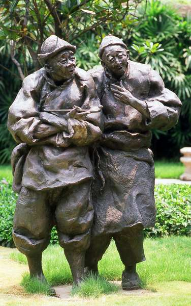 China: Ah Q (left) and friend, from 'The True Story of Ah Q', a novel by Lu Xun, Chen Family Temple (Chenjia Si), Guangzhou, Guangdong Province