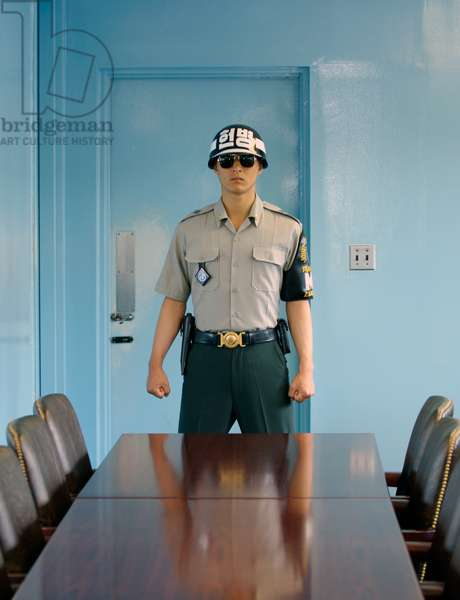 Korea: A Republic of Korea soldier of the United Nations Command Security Battalion standing guard inside a Joint Security Area conference room, Panmunjom, 2007