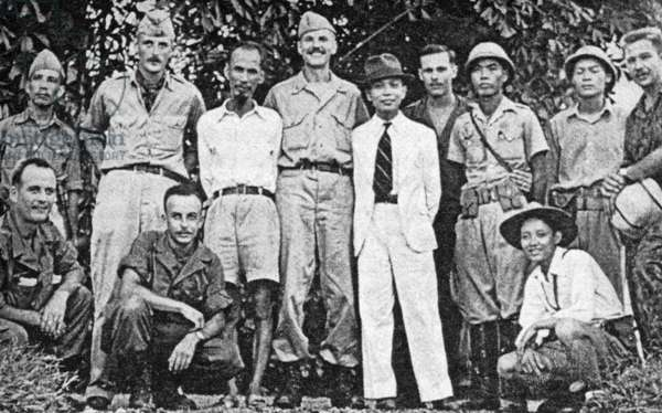 Vietnam: Ho Chi Minh (in shorts) and Vo Nguyen Giap (in white suit) with members of an Ameerican Office of Strategic Services (OSS) team at Tan Trao in northern Vietnam, August 1945