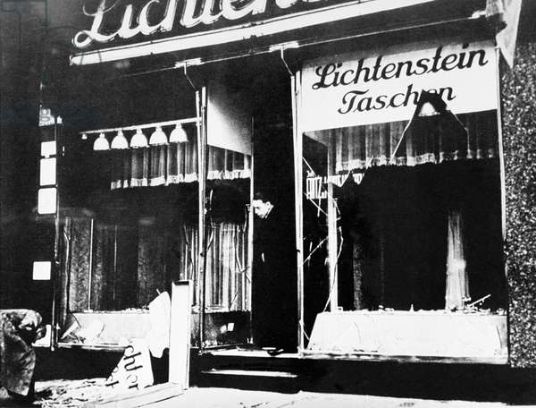 Germany: A man surveys the damage to the Lichtenstein leather goods store after the Kristallnacht pogrom, November 10, 1938 (b/w photo)