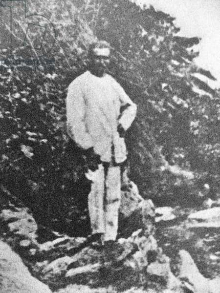 France/Ethiopia: Arthur Rimbaud (1854 - 1891) standing in front of a tree in Harar. Self-portrait, c. 1884