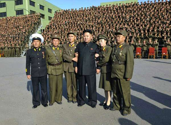 North Korea: Kim Jong Un (4th L) poses for a commemorative photo in Pyongyang on 23 October 2013 with participants in the 4th Meeting of KPA Company Commanders and Political Instructors