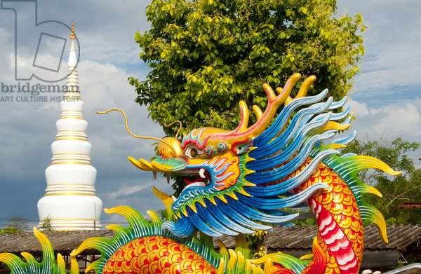 Thailand: Dragon with the chedi at Wat Tantayaphirom in the background, Kiuyong La Chinese shrine (joss house), Trang Town, Trang Province, southern Thailand
