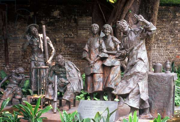 China: Storytelling, a sculpture from a Lu Xun novel, Chen Family Temple (Chenjia Si), Guangzhou, Guangdong Province