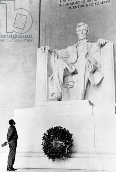 Cuba: Fidel Castro, Cuban Prime Minister, places a wreath at the Lincoln Memorial in Washington DC, c. 1959