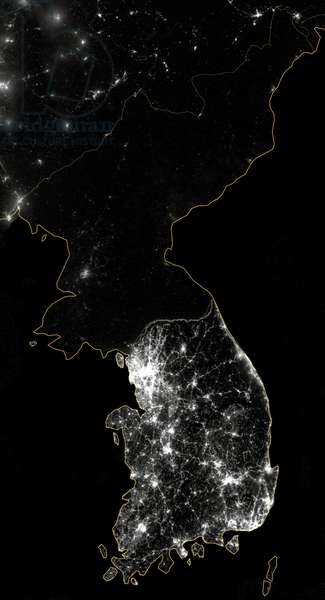 Korea: The Korean Peninsula at night, shown in a composite photograph. The amount of light is a direct indicator of economic activity distinguishing South Korea from the unilluminated North. NASA, 8 December 2012