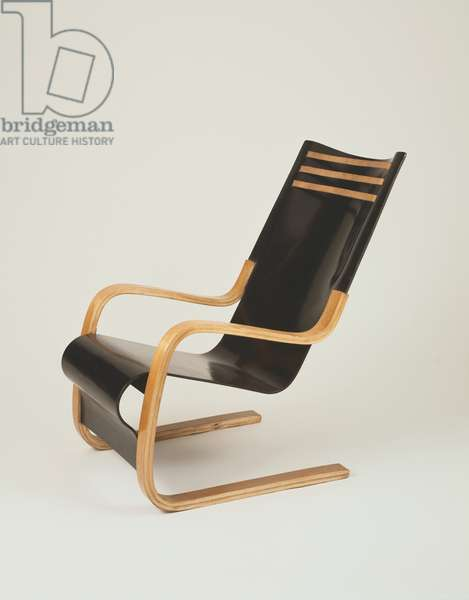 Armchair c.1931-32 (birch-faced plywood, laminated birch frame & leather straps)