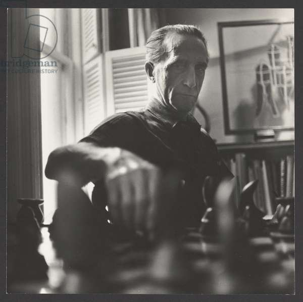 Duchamp Playing Chess (Nine Malic Molds in Background), New York, 1957 (gelatin silver print)