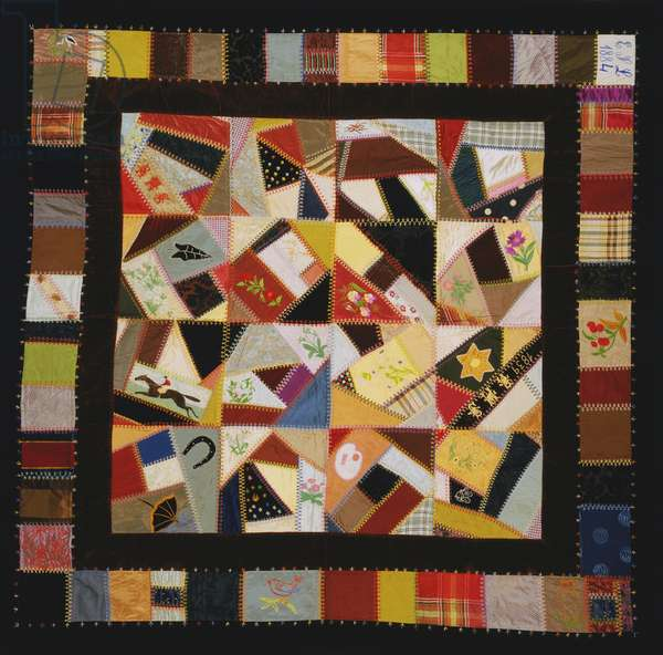 Crazy Quilt with Pieced Border, 1880s (patchwork of silk velvet, figured plain weave, printed silks, & jacquard-weave silk ribbons with silk embroidery in herringbone, fern, outline, satin, buttonhole, overcast, and straight stitches & French knots)