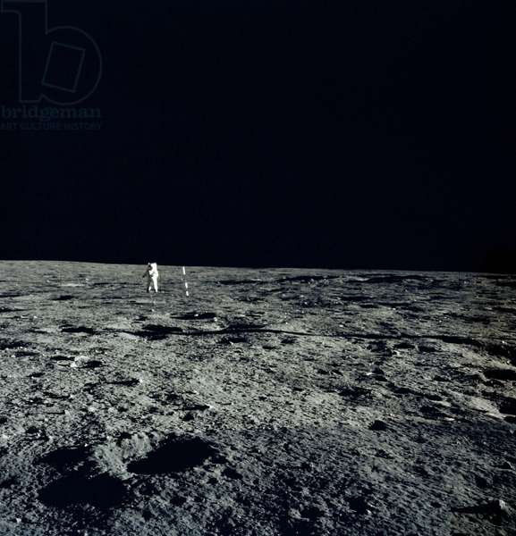 Apollo 12: A. Bean on the Moon - Apollo 12: Alan Bean on the moon - Alan Bean near Solar Wind Composition (SWC). 11/1969. View to the north showing Al Bean, who takes a photo of the Solar Wind Collector (SWC), which is just to the right of Al