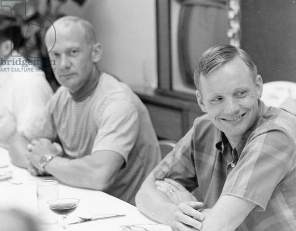 Apollo 11: E. Aldrin & N. Armstrong - Edwin Aldrin and Neil Armstrong have breakfast before leaving for the Moon. 16/07/1969. Edwin Aldrin and Neil Armstrong during breakfast on launch morning. Jul 16 1969