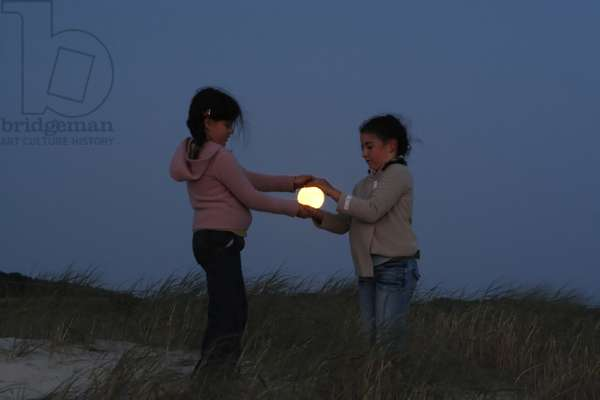 Moon Game - Moon game - Children play with the Moon. August 28, 2007. Children playing with the moon. August 28, 2007