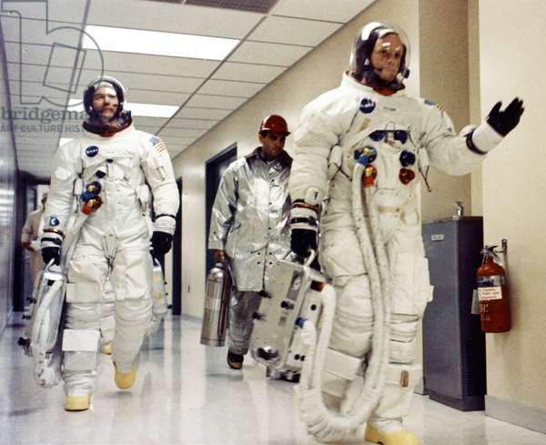 Apollo 11 astronauts depart - Apollo 11 crew on their way to launch pad - Neil Armstrong, Edwin Aldrin (cache by Collins) and Michael Collins head to the launch site. 16/07/1969. Neil Armstrong with Michael Collins, (E.Aldrin is behind hidden by Collins) on their way to Launch Complex. Jul 16 1969