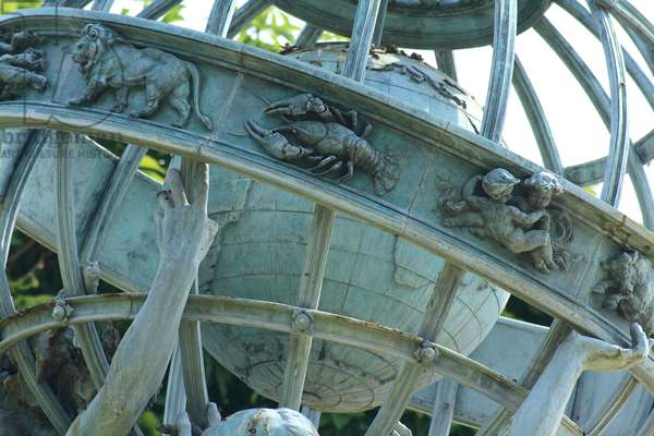 Fontaine des Quatre parts du monde (Paris 6eme) - Fontaine de l'Observatoire - Detail of the fountain located on the meridien of Paris, in the Marco Polo garden, close to the Observatory. Designed by architect Gabriel Davioud, it represents four young women symbolizing the four main continents, lifting a sphere centred on Earth and girded by the zodiac. The Fontaine de l'Observatoire is a monumental fountain located south of the Jardin du Luxembourg in the 6th arrondissement of Paris, with sculpture by Jean - Baptiste Carpeaux. It was dedicated in 1874. It is also known as the Fontaine des Quatre - Parts - du - Monde, for the four parts of the world embodied by its female figures