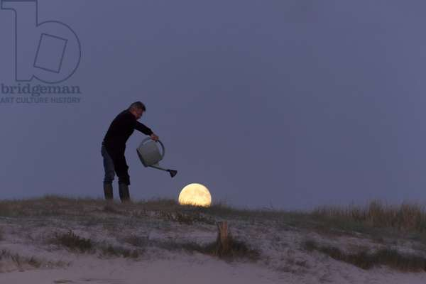 Gardening by the Moon - Michel watering the Moon with a watering can