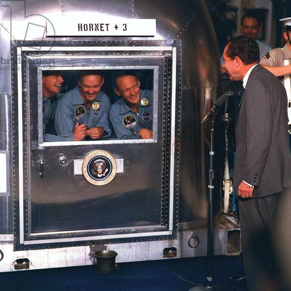 Apollo 11: astronauts in quarantine and R.Nixon - Apollo 11 astronauts visited by president Nixon - Visit of President Nixon to astronauts in quarantine aboard the U.S.S. Hornet. President Richard M. Nixon welcomes the Apollo 11 astronauts aboard the U.S.S. Hornet. Already confined to the Mobile Quarantine Facility are (left to right) Neil A. Armstrong, commander; Michael Collins, command module pilot; and Edwin E. Aldrin Jr., lunar module pilot