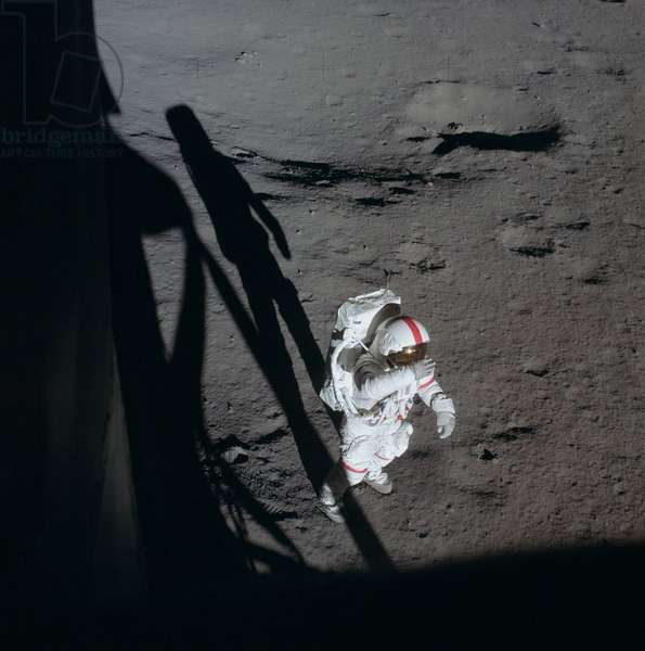 Apollo 14: A. Shepard on the Moon - Apollo 14: A.Shepard moonwalk - Extra vehicle exit by astronaut Alan Shepard. 05/02/1971 Astronaut Alan B. Shepard Jr., commander, holds his right glove over his helmet visor as if to shade his eyes from the brilliant sun. This photo was taken by astronaut Edgar D. Mitchell, lunar module pilot, through the window of the Lunar Module (LM). Shepard and Mitchell descended in the LM to explore the moon, while astronaut Stuart A. Roosa, command module pilot, remained with the Command and Service Modules (CSM) in lunar orbit. This photograph was taken during the first of two extravehicular activities (EVA). 5 Feb. 1971