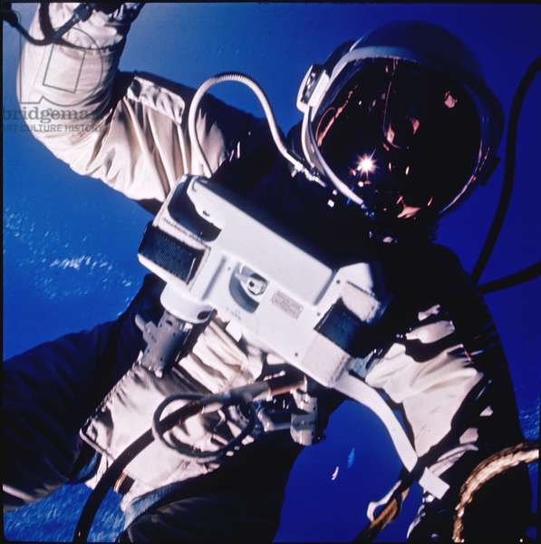 Gemini 4: release of Ed.White - Gemini 4: Ed White EVA - First release of an American into space made by Edward White on June 3, 1965. June 03, 1965 Gemini 4 astronaut Ed White is shown here during his spacewalk extra - vehicular activity (EVA). This was the first spacewalk by a U.S. astronaut. It lasted 23 minutes. White initially used a gas powered gun to move about. After the first three minutes the fuel ran out and White maneuvered by twisting his body and pulling on the 8 meter long umbilical cord. The photographs were taken by commander James McDivitt