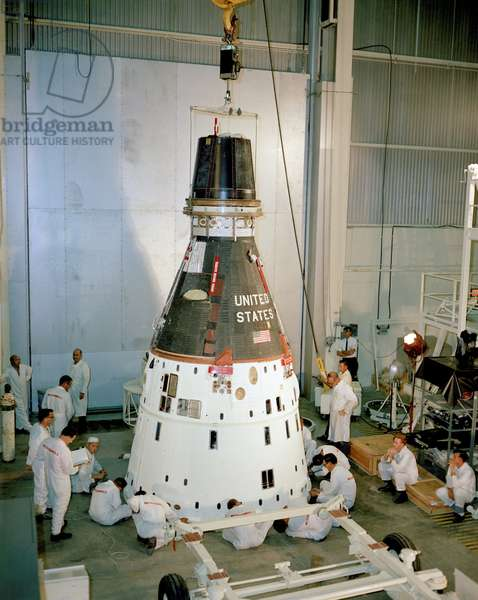 Gemini 11 in preparation before launch - Gemini 11 in preflight maintenance - View of the Gemini 11 ship in preparation at the Kennedy Space center in July 1966. The Gemini 11 spacecraft is lowered onto a dolly for preflight maintenance before stacking on the Titan rocket at the Kennedy Space Center. Dick Gordon and Pete Conrad would liftoff in this spacecraft on September 12, 1966 for a mission lasting almost three days. The crew practiced docking with the Agena unmanned docking craft, and Gordon also performed two spacewalks during the mission
