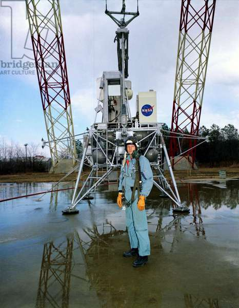 """Apollo 11: N. Armstrong 02/1969 - Neil Armstrong ahead of the LEM prototype """""""" LLRV"""" (Lunar Landing Research Vehicle), at the Langley Research Center. 12/02/1969 Neil Armstrong with the LLRV (Lunar Landing Research Vehicle) at Langley Lunar Landing Research Facility February 12, 196"""