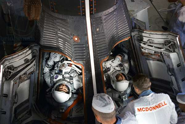 "Gemini 5: astronauts before decollage - Gemini 5: astronauts prior launching - Astronauts Gordon Cooper (left) and Charles """" Pete"""""" Conrad in Gemini 5 capsule before decollage. 21 August 1965. Astronauts Gordon Cooper (left) and Charles """" Pete"""""" Conrad seen in the Gemini 5 spacecraft. Aug 21 1965"
