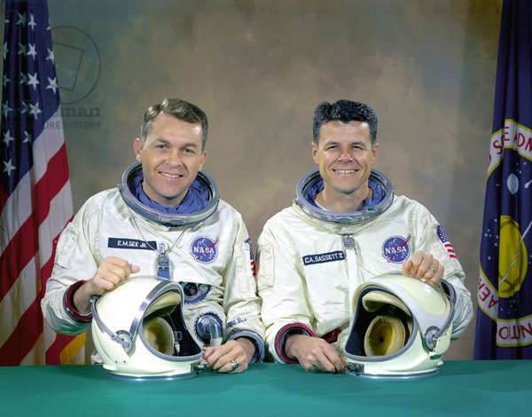 Gemini 9: Original crew - The original Gemini 9 prime crew - Original crew of the Gemini 9 mission consists of Elliot See, on the left, and Charles Bassett. These two men were killed in a plane crash four months before the mission. 5 January 1966. The original Gemini 9 prime crew, astronauts Elliot M. See Jr. (left), command pilot, and Charles A. Bassett II, pilot, in space suits with their helmets on the table in front of them. On February 28, 1966 the prime crew for the Gemini 9 mission were killed when their twin seat T - 38 trainer jet aircraft crashed into a building in which the Gemini spacecraft were being manufactured. They were on final approach to Lambert - Saint Louis Municipal Airport when bad weather conditions hampered pilot See's ability to make a good visual contact with the runway. Noticing the building at the last second as he came out of the low cloud cover, See went to full afterburner and attempted to nose - up the aircraft in an attempt to miss the building. He clipped it and his plane crashed