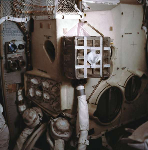 "Apollo 13: system to purge CO2 - Apollo 13: system to purge carbon dioxide - The makeshift box (nicknamed ""mailbox"") built by the crew of Apollo 13 to purge CO2 inside the lunar module after the explosion of an oxygen tank. 04/1970. Interior view of the Apollo 13 Lunar Module (LM) showing the """" mail box"""", a jerry - rigged arrangement which the Apollo 13 astronauts built to use the Command Module lithium hydroxide canisters to purge carbon dioxide from the Lunar Module"