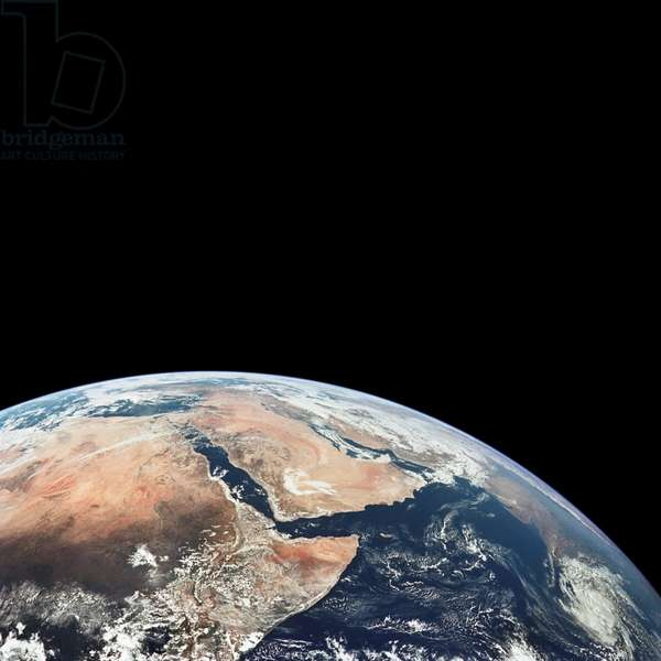 Apollo 17: Africa and Saudi Arabia - Part of Africa and Saudi arabia - Apollo 17 - View of Saudi Arabia and the north eastern portion of the African continent was photographed by the Apollo 17 astronauts with a hand - held camera on their translunar coast towards lunar landing. Egypt, Sudan and Ethiopia are some of the African nations visible. Iran, Iraq and Jordan are not so clearly visible because of cloud cover and their particular location in this picture. India is dimly visible at right of frame. The Red Sea is seen entirely in this one frame. The Gulf of Suez, the Dead Sea, Gulf of Aden, Persian Gulf and Gulf of Oman are also visible. December 7 1972