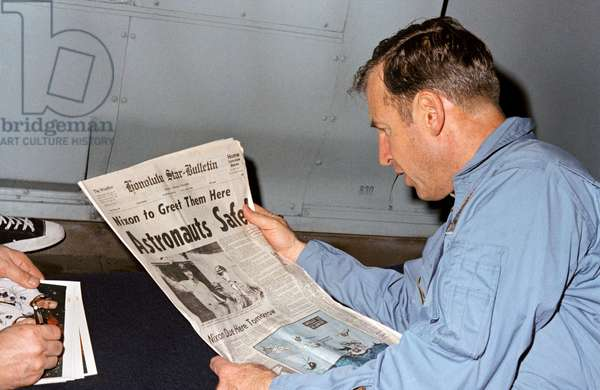 Apollo 13: Astronaut Jim Lovell - Apollo 13: Jim Lovell - Astronaut Jim Lovell discovers the story of the Apollo 13 mission rescue in the press. He is aboard the USS Iwo Jima airplane door. 17 April 1970. Astronaut James A. Lovell Jr., Apollo 13 mission commander, reads a newspaper account of the safe recovery of the problem plagued mission. Lovell is on board the U.S.S. Iwo Jima, prime recovery ship for Apollo 13, which was on a course headed for Pago Pago. From Pago Pago the astronauts flew to Hickham Air Force Base, Hawaii, where they were presented the Presidential Medal of Freedom by President Richard M. Nixon. Other Apollo 13 crew members were astronauts John L. Swigert Jr., command module pilot, and Fred W. Haise Jr., lunar module pilot. 17 April 1970