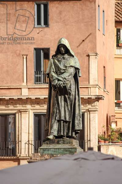 Statue of Giordano Bruno a Rome - Monument to Giordano Bruno in Rome: Bronze statue of Giordano Bruno (1889) by Ettore Ferrari (1845-1929), Campo dei Fiori, Rome. Giordano Bruno (1548-1600), Dominican monk, philosopher, victim of the Inquisition. On the basis of Copernicus's work, he shows in a philosophical way the relevance of an infinite universe, people of a countless number of worlds identical to ours. Accused of heresie, book at the Inquisition and torture, he was sentenced to death and burnt alive in Rome on 16 February 1600. The bronze monument to Giordano Bruno (1889) by Ettore Ferrari (1845-1929), Campo dei Fiori, Rome. Giordano Bruno (1548-1600) was an Italian Dominican friar, philosopher, mathematician and astronomer, who was found guilty of heresy and burnt by the Inquisition because of his works about the infinity of the universe.